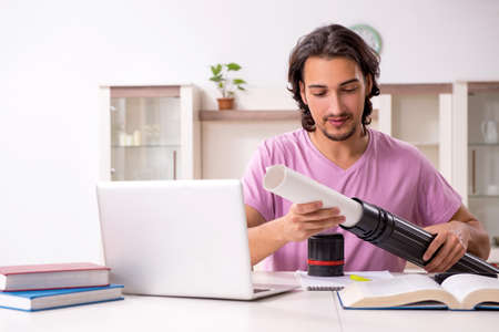 Young male architect student preparing for exams at home