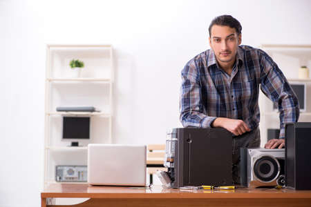Young engineer repairing musical hi-fi system Stok Fotoğraf