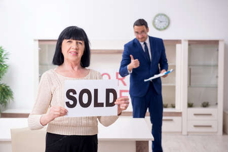 Male real estate agent and female client in the apartment Stok Fotoğraf