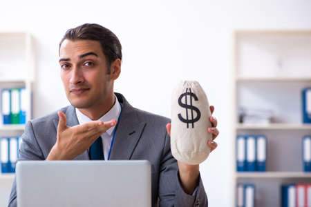 Young male accountant working in the office Stock Photo - 132234288