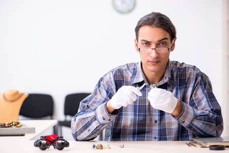 Young male jeweler at workshop
