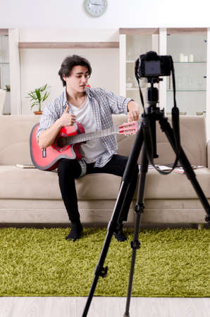 Young guitar player recording video for his blog Stok Fotoğraf
