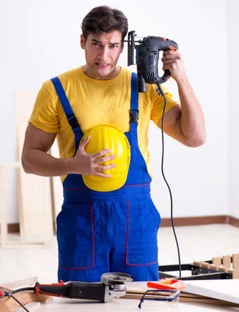 Floor repairman disappointed with his work Banco de Imagens