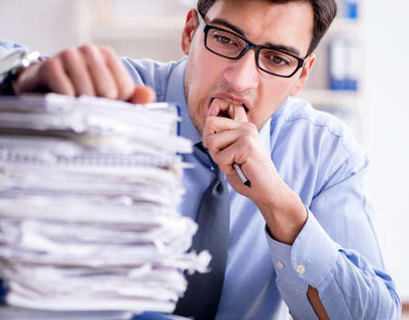 Extremely busy businessman working in office