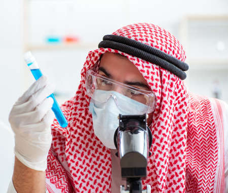 Arab chemist working in the lab office