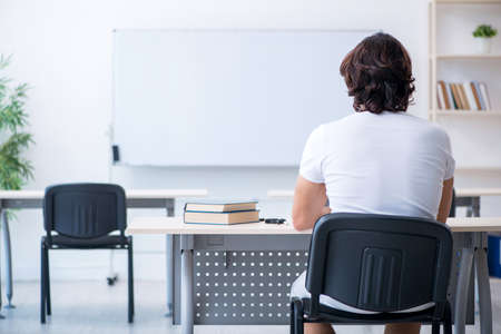 Young male student in front of whiteboard Stock Photo