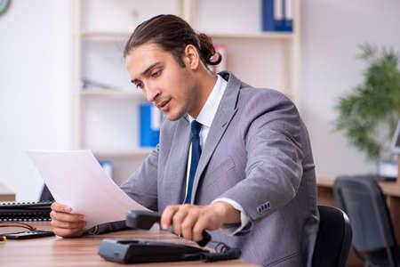 Unhappy male businessman in the office Banco de Imagens - 131759347