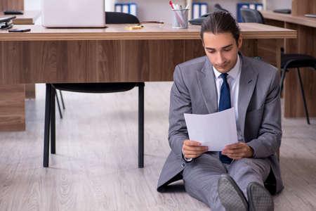 Unhappy male businessman in the office Banco de Imagens - 131759358