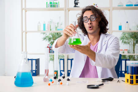 Funny male chemist working in the lab Reklamní fotografie - 131758710