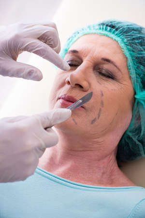 Old woman visiting male doctor for plastic surgery