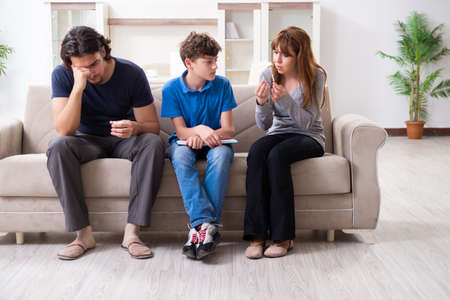 Concept of underage smoking with young boy and family Banco de Imagens