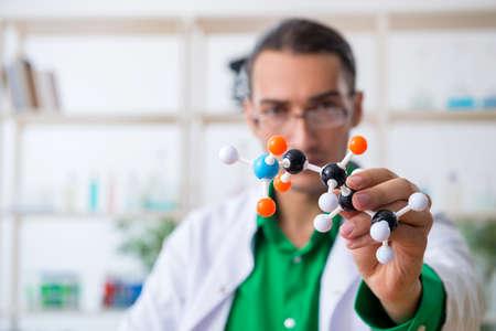 Young male chemist teacher in the lab Archivio Fotografico