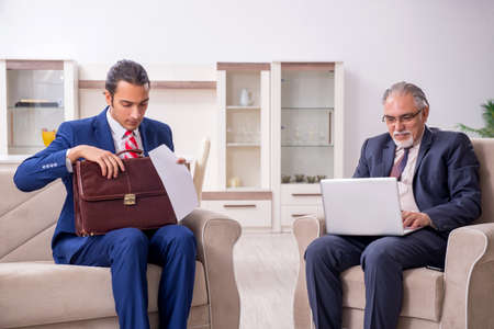 Two businessman discussing business in office Фото со стока - 131816504