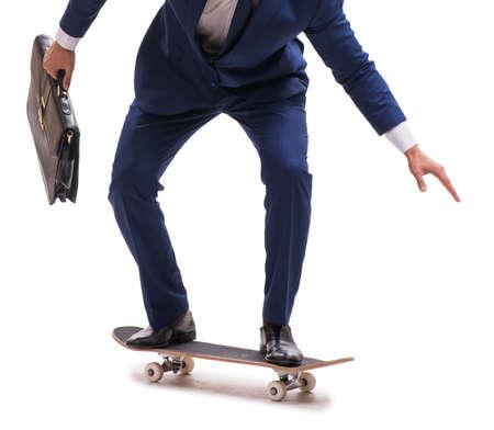 The businessman riding skateboard isolated on white background 版權商用圖片