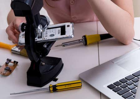 Mobile phone repair in workshop Stok Fotoğraf