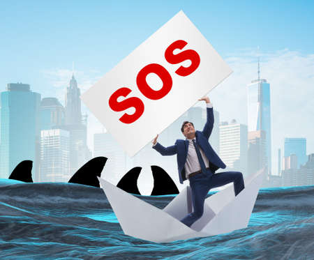 Businessman asking for help with SOS message on boat Reklamní fotografie