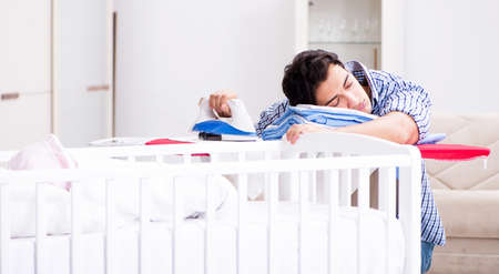 The young dad looking after newborn baby