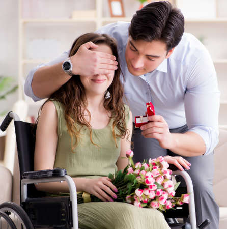 The man making marriage proposal to disabled woman on wheelchair