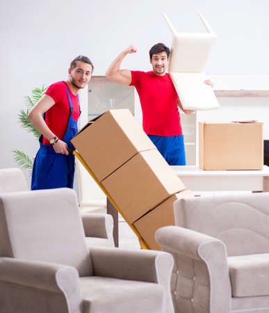 Two contractor employees moving personal belongings