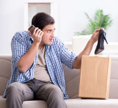 Man receiving wrong parcel with female woman shoes