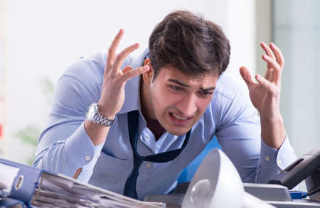 Angry businessman frustrated with too much work Stockfoto