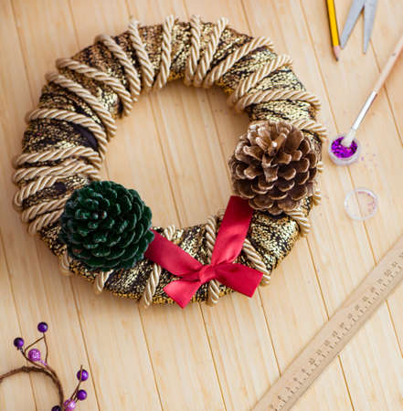 Woman doiing DIY festive decorations at home Reklamní fotografie