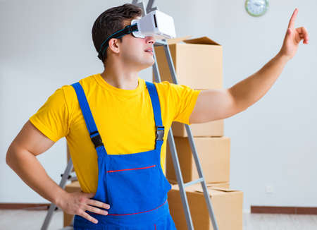 The painter contractor working with virtual reality goggles
