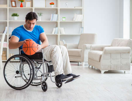Young basketball player on wheelchair recovering from injury 版權商用圖片