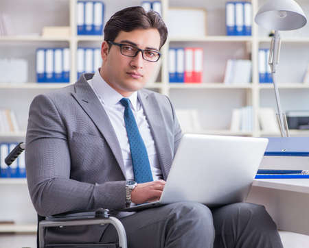 Disabled businessman working in the office 版權商用圖片