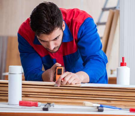 Yooung repairman carpenter working with paint painting 写真素材