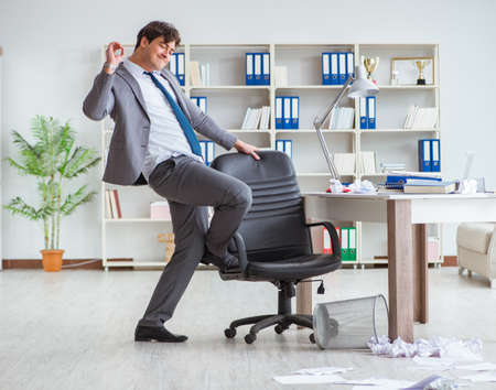 Businessman having fun taking a break in the office at work 写真素材 - 132082763