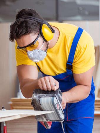 Carpenter working in the workshop 写真素材