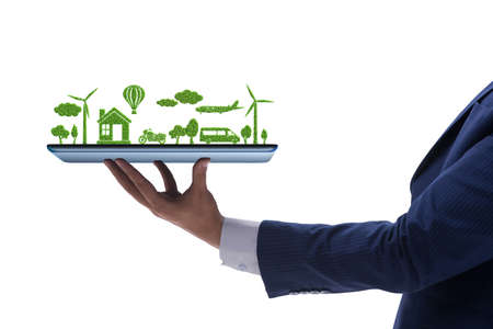 The hand holding tablet with mini ecosystem and clean energy