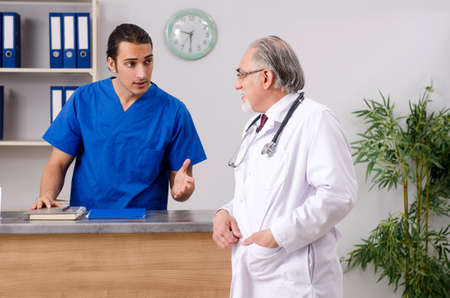 Two doctors talking at the reception in hospital