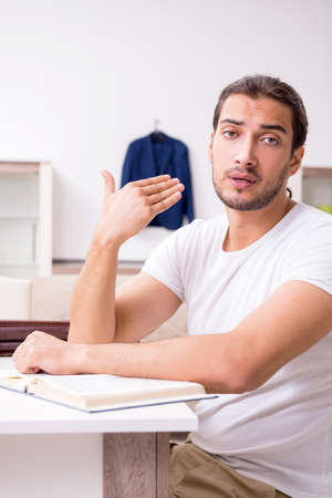 Young male student preparing for exams at home Stok Fotoğraf