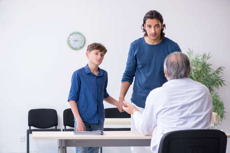 Young boy visiting doctor in hospital