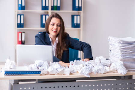 Businesswoman rejecting new ideas with lots of papers Stock Photo