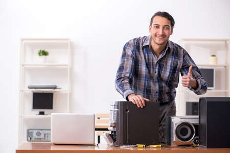 Young engineer repairing musical hi-fi system Stock Photo