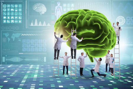 Team of doctors examining human brain
