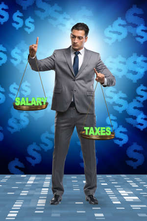 Businessman trying to find balance between taxes and salary Stock Photo - 132404398