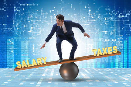Businessman balancing between taxes and salary Stock Photo