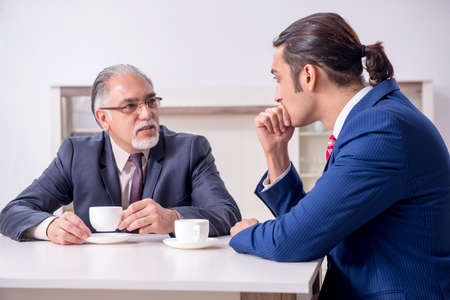 Two businessman discussing business in office Stock fotó