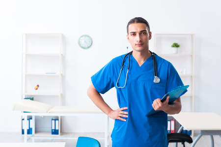 Young male doctor working in the clinic