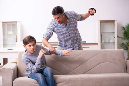 Father beating and punishing his sone Stock Photo