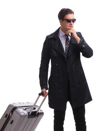 The young businessman with suitcase ready for business trip on w