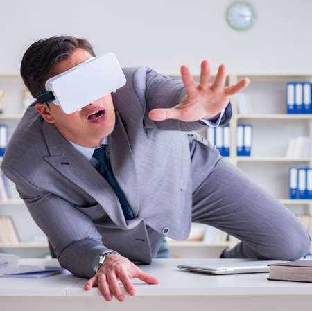 Businessman with virtual reality glasses in modern technology co