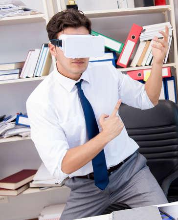 The employee watching movie on vr virtual reality glasses Фото со стока