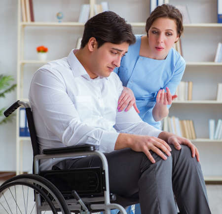 Disabled patient on wheelchair visiting doctor for regular check