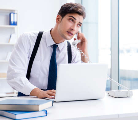 Young stylish businessman working in the office Stockfoto