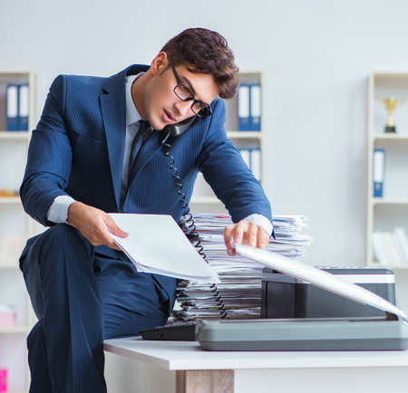 The businessman making copies in copying machine Stock Photo